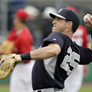 New York Yankees first baseman Mark Teixeira warms up before an exhibition baseball game against the Philadelphia Phillies, Thursday, March 6, 2014, in Clearwater, Fla The Associated Press