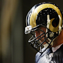 Rams tackle Mitchell Van Dyk takes a quick water break during the first day of NFL football training camp for rookies on Tuesday, July 22, 2014, at Rams Park in Earth City, Mo The Associated Press