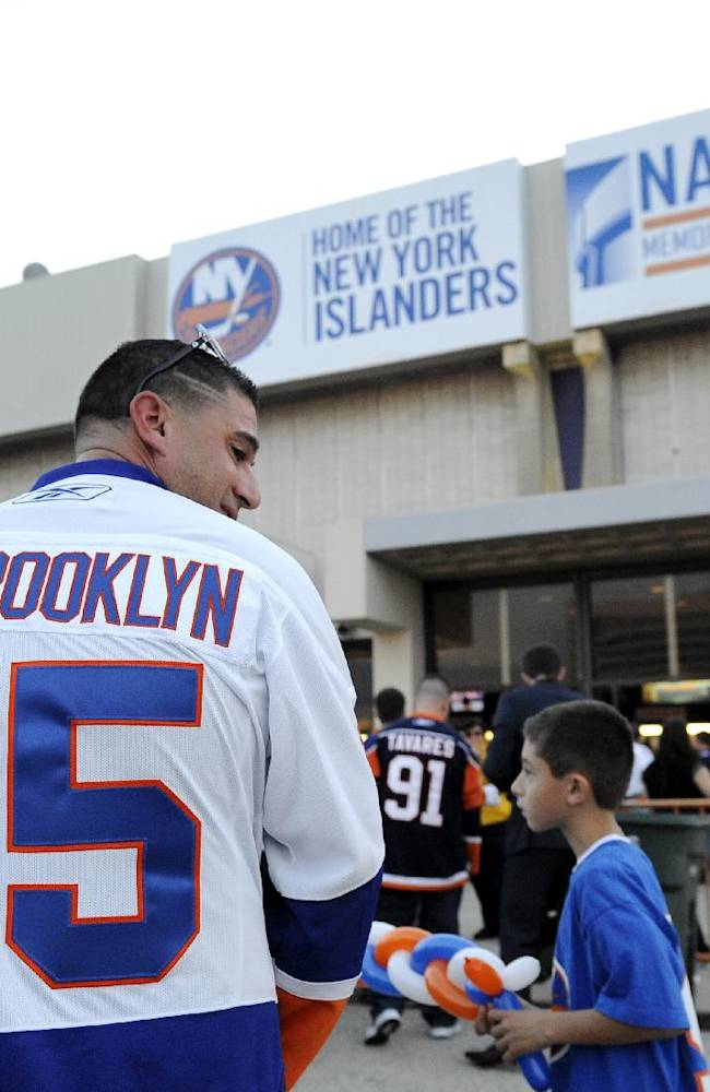 New York Islanders fan Jack D'Alessandro of Westbury, N.Y., waits in line to attend an NHL hockey game against the Columbus Blue Jackets on Saturday, Oct. 5, 2013, in Uniondale, N.Y