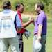 KAVARNA, BULGARIA - MAY 19:  Graeme McDowell of Northern Ireland (centre) shakes hands with Branden Grace of South Africa after his victory in the semi-final of the Volvo World Match Play Championship at Thracian Cliffs Golf & Beach Resort on May 19, 2013 in Kavarna, Bulgaria.  (Photo by Andrew Redington/Getty Images)