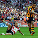 Hull City's Tom Huddlestone, right, scores against Sheffield United during their English FA Cup semifinal soccer match between Hull City and Sheffield United at Wembley Stadium, London, England, Sunday, April 13, 2014