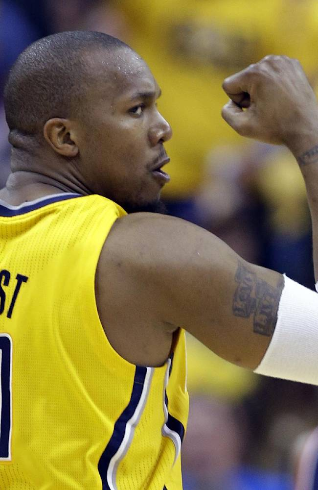 Indiana Pacers forward David West celebrates a bucket against the Washington Wizards during the second quarter of game 1 of the Eastern Conference semifinal NBA basketball playoff series in Indianapolis, Monday, May 5, 2014