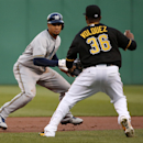 Pittsburgh Pirates starting pitcher Edinson Volquez (36) catches Milwaukee Brewers' Carlos Gomez in a rundown between second and third during the first inning of a baseball game in Pittsburgh, Thursday, April 17, 2014. Gomez made it back to second safely