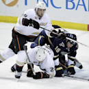 St. Louis Blues' Jay Bouwmeester (19) gets tangled up with Anaheim Ducks' Matt Beleskey (39) and Kyle Palmieri (21) in the third period of an NHL hockey game, Saturday, Dec. 7, 2013, in St. Louis The Associated Press