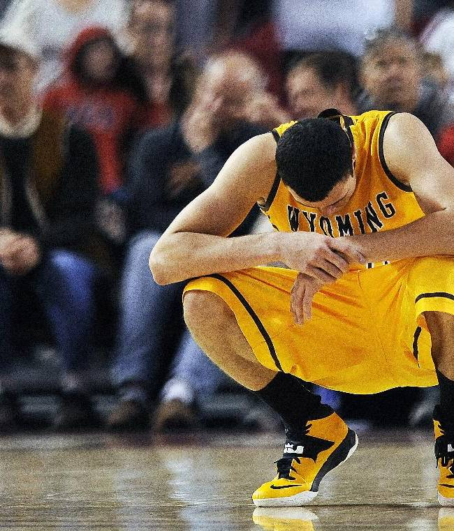 Wyoming Cowboys forward Larry Nance Jr. hangs his head after Wyoming missed their final shot attempt in the second half of a men's college NCAA basketball game against the Denver Pioneers on Sunday, Dec. 15, 2013, in Denver. Denver won 64-61