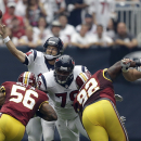 Houston Texans' Ryan Fitzpatrick (14) throws against the Washington Redskins during the first quarter of an NFL football game Sunday, Sept. 7, 2014, in Houston The Associated Press