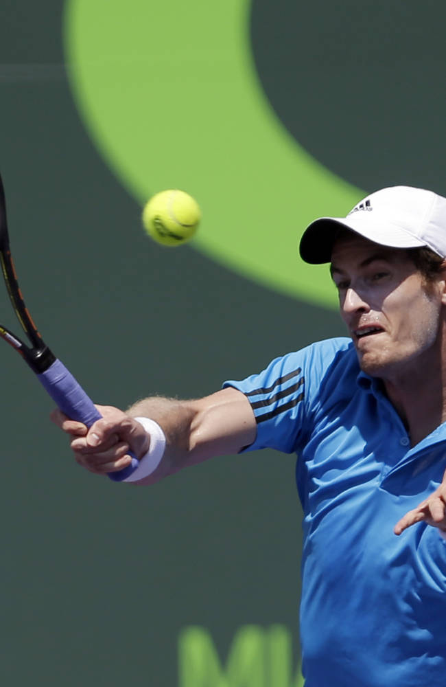 Andy Murray, of Great Britain, returns to Feliciano Lopez, of Spain, at the Sony Open tennis tournament in Key Biscayne, Fla., Sunday, March 23, 2014. (AP Photo/Alan Diaz)