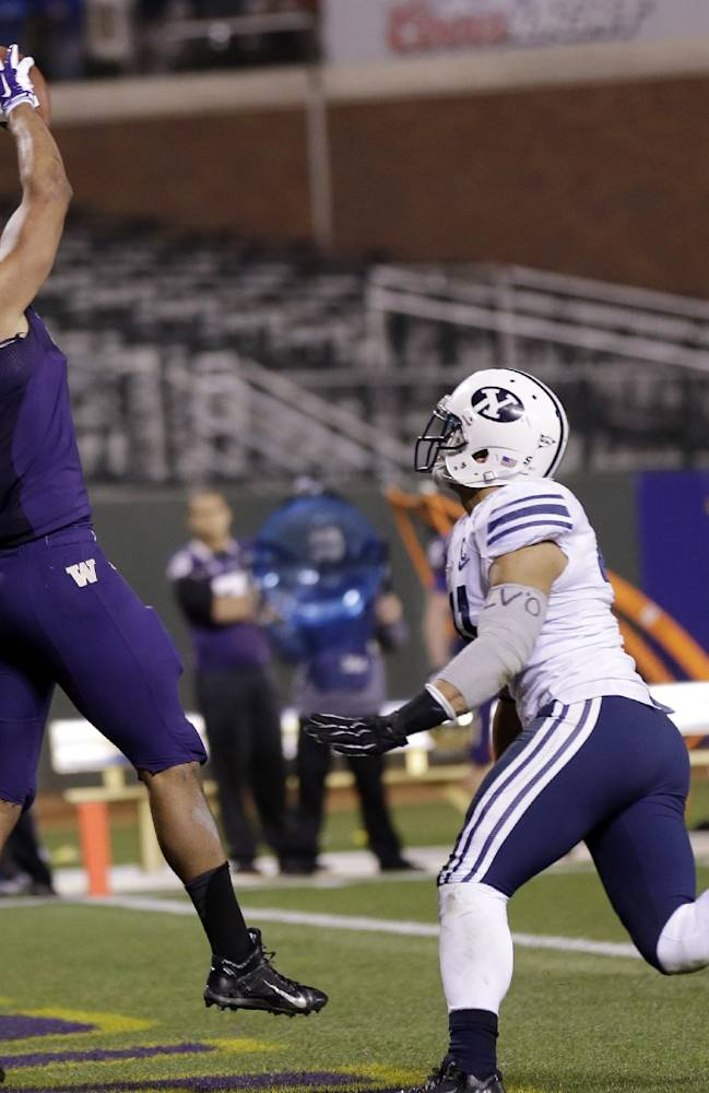 Washington tight end Austin Seferian-Jenkins catches a touchdown past in front of BYU linebacker Uani Unga, center, during second half of the Fight Hunger Bowl NCAA college football game, Friday, Dec. 27, 2013, in San Francisco. Washington won 31-16