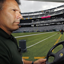 In this Oct. 15, 2014, photo, Daniel DeLorenzi, director of security and safety services at MetLife Stadium, home of the New York Giants and the York Jets football teams, drives a cart in the stadium in East Rutherford, N.J. The cameras installed late las