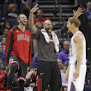 Chicago Bulls' Joakim Noah, left, and Carlos Boozer, center, react after Charlotte Bobcats' Luke Ridnour, right, was called for a foul during the first half of an NBA basketball game in Charlotte, N.C., Wednesday, April 16, 2014 The Associated Press