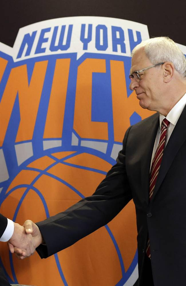 New York Knicks new team president Phil Jackson, right, shakes hands with Madison Square Garden Chairman James Dolan during a news conference where he was introduced, at New York's Madison Square Garden, Tuesday, March 18, 2014