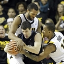 Butler guard Alex Barlow (3) is trapped by Virginia Commonwealth center D.J. Haley, left, and guard Darius Theus (10) during the second half of an NCAA college basketball game in Richmond, Va., Saturday, March 2, 2013.  VCU won 84-52.  (AP Photo/Steve Helber)