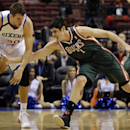 Milwaukee Bucks' Ersan Ilyasova (7), of Turkey, knocks the ball loose from Philadelphia 76ers' Spencer Hawes (00) during the first half of an NBA basketball game on Friday, Nov. 22, 2013, in Philadelphia The Associated Press