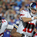 New York Giants quarterback Eli Manning reacts after being hit by San Diego Chargers defensive tackle Lawrence Guy while throwing a pass during the first half of an NFL football game Sunday, Dec. 8, 2013, in San Diego The Associated Press