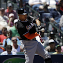 Miami Marlins' Giancarlo Stanton hits a double to score teammate Jeff Mathis in the sixth inning of a baseball game against the Atlanta Braves, Wednesday, April 23, 2014, in Atlanta The Associated Press