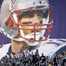 Fans cheer under a banner of New England Patriots quarterback Tom Brady (12) before the NFL Super Bowl XLIX football game between the Seattle Seahawks and the New England Patriots Sunday, Feb. 1, 2015, in Glendale, Ariz. (AP Photo/Matt Slocum)