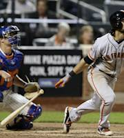 San Francisco Giants' Angel Pagan watches his eighth-inning RBI hit off New York Mets relief pitcher Gonzalez Germen in a baseball game Tuesday, Sept. 17, 2013, in New York. At left is Mets catcher Anthony Recker. (AP Photo/Kathy Willens)