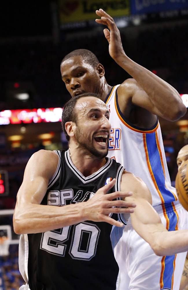 San Antonio Spurs guard Manu Ginobili (20) drives past Oklahoma City Thunder forward Kevin Durant in the third quarter of Game 3 of an NBA basketball playoff series in the Western Conference finals, Sunday, May 25, 2014, in Oklahoma City. Oklahoma City won 106-97