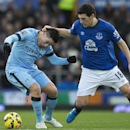 Everton's Gareth Barry, right, grabs Manchester City's Samir Nasri during the English Premier League soccer match between Everton and Manchester City at Goodison Park Stadium, Liverpool, England, Saturday Jan. 10, 2015