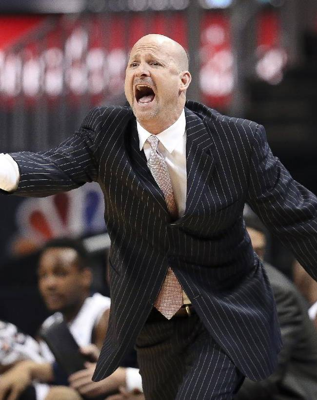 Mississippi head coach Andy Kennedy directs his players from the bench in the first half of an NCAA college basketball game against Penn State, the championship game of the Barclays Center Classic, Saturday, Nov. 30, 2013, in New York