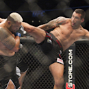 New Zealand's Mark Hunt, left,  battles against Brazil's Fabricio Werdum from during a UFC 180 interim Heavyweight title fight in Mexico City, Saturday, Nov. 15, 2014. Werdum won the fight by KO/TKO. (AP Photo/Christian Palma)