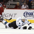 Arizona Coyotes' Michael Stone (26) trips up San Jose Sharks' Eriah Hayes (76) as Sharks' Marc-Edouard Vlasic (44) watches during the first period of a preseason NHL hockey game Friday, Oct. 3, 2014, in Glendale, Ariz The Associated Press
