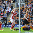 Stoke City's Ryan Shawcross, centre, jubilates after scoring his teams first goal against Hull City, during their English Premier League match at the KC Stadium, Hull, England, Sunday Aug, 24, 2014