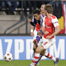 Anderlecht's Andy Najar,left shoots at goal,under pressure from Arsenal's Nacho Monreal during the Group D Champions League match between Anderlecht and Arsenal at Constant Vanden Stock Stadium in Brussels, Belgium, Wednesday Oct. 22, 2014