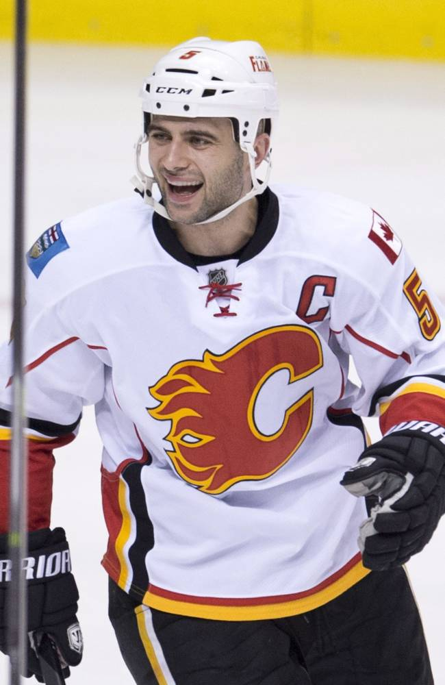 Calgary Flames defenseman Mark Giordano celebrates his goal during the second period against the Vancouver Canucks in an NHL hockey game Saturday, Jan. 18, 2014, in Vancouver, British Columbia