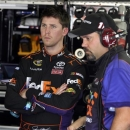 Denny Hamlin, left, talks with crew chief Darian Grubb, right, during practice for the NASCAR Sprint All-Star auto race at Charlotte Motor Speedway in Concord, N.C., Friday, May 17, 2013. (AP Photo/Bob Jordan)
