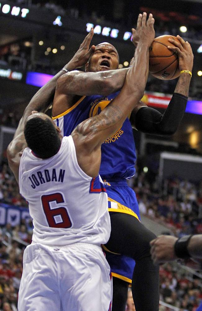 In this Oct. 31, 2013 file photo, Los Angeles Clippers center DeAndre Jordan (6) blocks a shot by Golden State Warriors forward Marreese Speights, top, in the third quarter during an NBA basketball game in Los Angeles. The Clippers and Warriors meet Saturday, April 19, 2014, and figure to create the best theater of any first-round playoff matchup