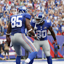 New York Giants wide receiver Victor Cruz (80) celebrates with tight end Daniel Fells (85) after Fells caught a touchdown pass against the Houston Texans in the fourth quarter of an NFL football game, Sunday, Sept. 21, 2014, in East Rutherford, N.J The As