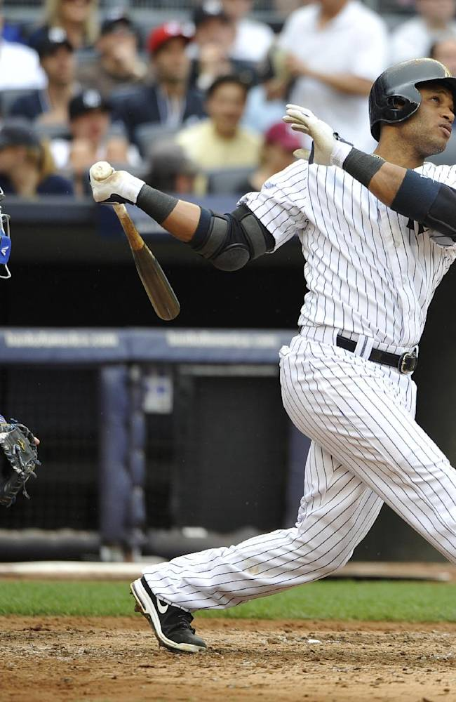 In this May 18, 2013 file photo, Toronto Blue Jays catcher J.P. Arencibia and New York Yankees Robinson Cano watch Cano's two-run home run off of starting pitcher Brandon Morrow in the fifth inning of a baseball game at Yankee Stadium in New York. Cano, a five-time All-Star second baseman, is a free agent. He is seeking a 10-year contract for more than $300 million from the Yankees. Jay Z, the new agent for Cano, had dinner Monday night, Nov. 18, 2013, with top officials of the New York Mets