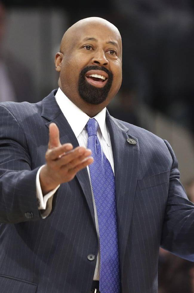 New York Knicks head coach Mike Woodson reacts to a call during the first half of an NBA basketball game against the Washington Wizards Friday, April 4, 2014, in New York