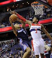 Charlotte Bobcats guard Gerald Henderson (9) goes to the basket against Washington Wizards guard Bradley Beal (3) during the first half of an NBA basketball game on Wednesday, April 9, 2014, in Washington. (AP Photo/Nick Wass)