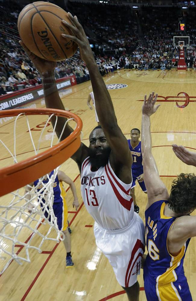 Houston Rockets' James Harden (13) dunks the ball as Los Angeles Lakers' Pau Gasol (16) defends during the first quarter of an NBA basketball game Thursday, Nov. 7, 2013, in Houston