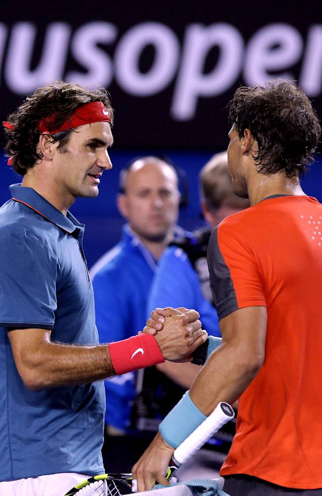Rafael Nadal of Spain, right,  shakes hands with Roger Federer of  Switzerland at the net after Nadal won their semifinal at the Australian Open tennis championship in Melbourne, Australia, Friday, Jan. 24, 2014