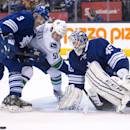 Toronto Maple Leafs defenceman Dion Phaneuf (3) ties up Vancouver Canucks forward Derek Dorsett (51) as Maple Leafs goalie Jonathan Bernier (45) watches the puck during third period NHL hockey action in Toronto on Saturday, Dec. 6, 2014 The Associated Pre