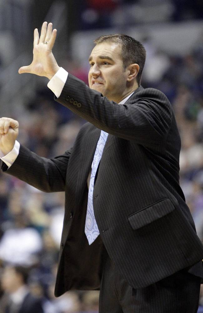 In this Nov. 15, 2011 file photo, Indiana-Purdue Fort Wayne basketball coach Tony Jasick calls a play in the first half of an NCAA college basketball game against the Xavier, in Cincinnati. Jacksonville University has hired Jasick as its men's basketball coach. The 36-year-old Jasick signed a five-year contract with Jacksonville