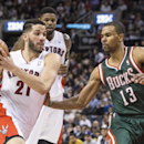 Toronto Raptors' Greivis Vasquez, left, drives towards Milwaukee Bucks' Ramon Sessions during second half NBA basketball action in Toronto on Monday April 14, 2014 The Associated Press