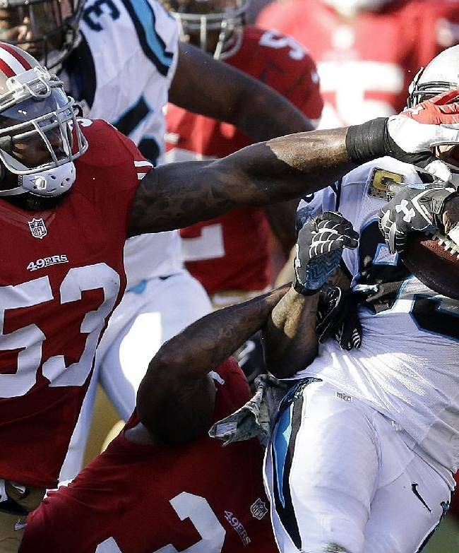 Carolina Panthers' Steve Smith, right, is tackled by San Francisco 49ers' NaVorro Bowman (53) during the third quarter of an NFL football game in San Francisco, Sunday, Nov. 10, 2013