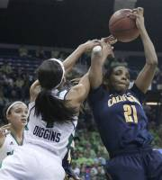 California forward Reshanda Gray (21) and Notre Dame guard Skylar Diggins reach for a rebound during the first half of a second-round NCAA women's tournament college basketball game in South Bend, Ind., Tuesday, March 20, 2012. (AP Photo/Charles Rex Arbogast)