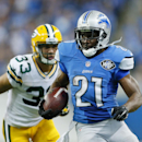 Detroit Lions running back Reggie Bush (21) breaks away from Green Bay Packers free safety Micah Hyde (33) for a 26-yard rushing touchdown during the second half of an NFL football game in Detroit, Sunday, Sept. 21, 2014 The Associated Press