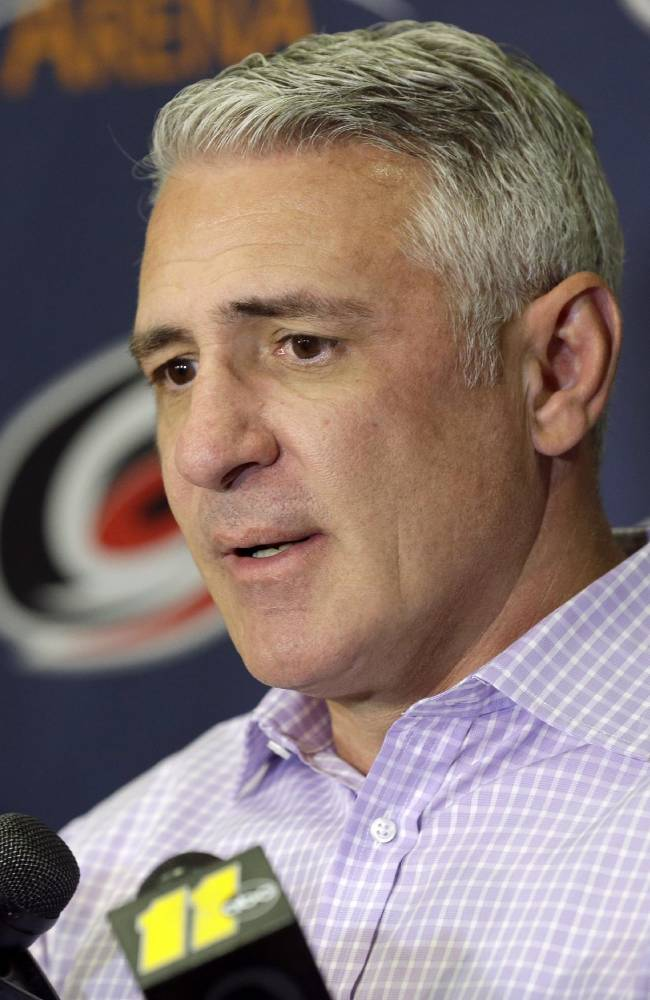 Carolina Hurricanes general manager Ron Francis answers reporters' questions during an NHL hockey media day in Raleigh, N.C., Thursday, Sept. 4, 2014