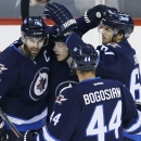 Winnipeg Jets' Zach Andrew Ladd (16), Bryan Little (18), Zach Bogosian (44) and Michael Frolik (67) celebrate Ladd's goal against the Pittsburgh Penguins during the first period of an NHL hockey game Thursday, Nov. 6, 2014, in Winnipeg, Manitoba The Assoc