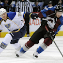 Colorado Avalanche center Matt Duchene takes the puck away from St. Louis Blues defenseman Ian Cole, left, in the second period of an NHL hockey game on Saturday, March 8, 2014, in Denver The Associated Press