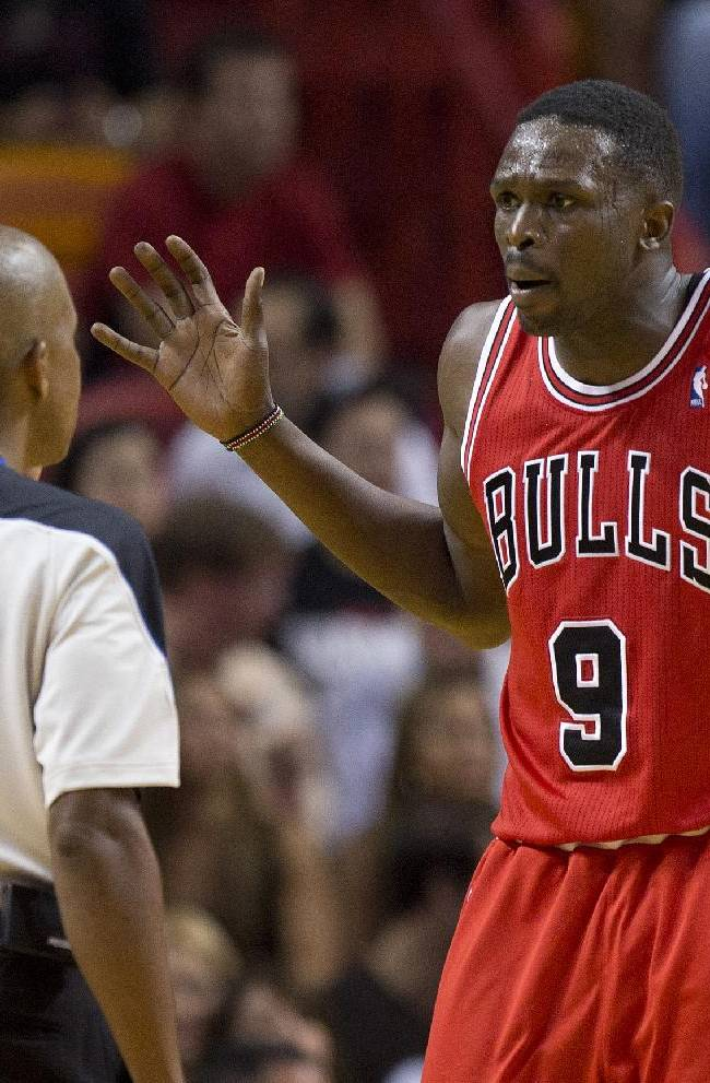 Chicago Bulls' Luol Deng protests a foul call to official Sean Corbin during the second half of the Bulls' NBA basketball game against the Miami Heat, in Miami on Tuesday, Oct. 29, 2013. The Heat won 107-95