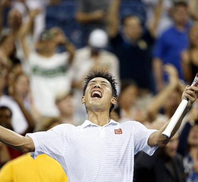 Kei Nishikori, of Japan, reacts after defeating Milos Raonic, of Canada, during the fourth round of the U.S. Open tennis tournament in the early morning hours of Tuesday, Sept. 2, 2014, in New York