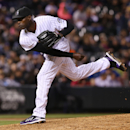 Colorado Rockies relief pitcher LaTroy Hawkins works against the Philadelphia Phillies in the ninth inning of the Rockies' 3-1 victory in a baseball game in Denver on Saturday, April 19, 2014. Hawkins earned his fifth save of the season for his effort The