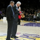 Los Angeles Lakers general manager Mitch Kupchak, right, speaks during a ceremony to retire the No. 52 jersey of former Laker